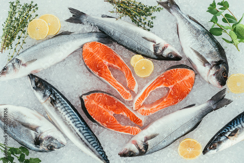 top view of assorted organic seafood and ingredients on ice
