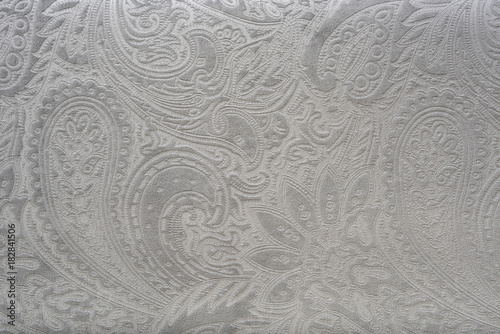 Gray or silver velvet fabric with a vintage elegant floral pattern or a luxury texture.