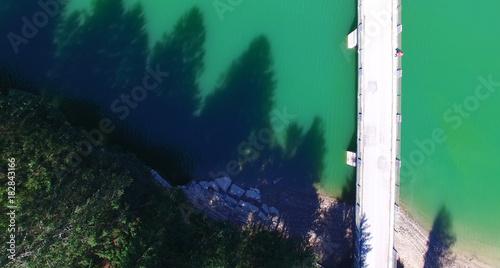Sticker Bridge over mountain river, overhead aerial view