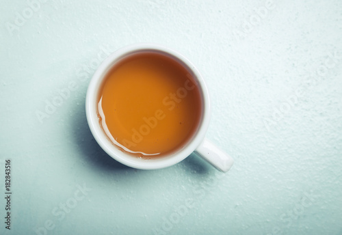 Cup with green tea on grey wooden background - 182843516