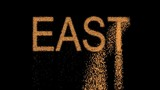 text EAST appears from the sand, then crumbles. Alpha channel Premultiplied - Matted with color black - 182845125
