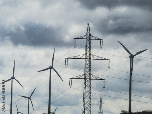 windmill and electricity pylons - 182848988