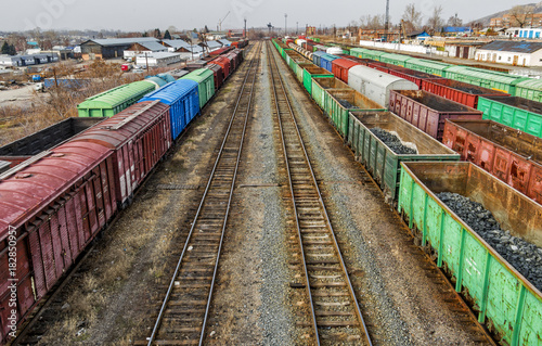 Freight wagons on railway station. Industrial district Poster