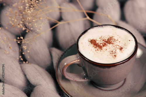 Fototapeta Cup of coffee on soft blanket. Cozy background