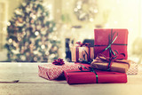 wrapped gifts on christmas tree background at home - 182862188