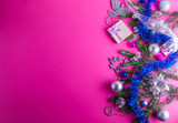 Pink Christmas background with a present and decorations - 182864710