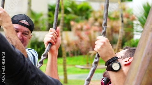 Friends/ Father and Son Playing in Swing