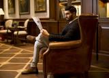 Modern businessman reading newspaper - 182874388
