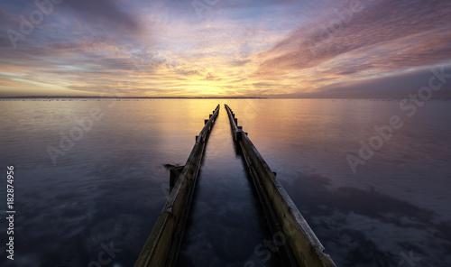 Fotobehang Grijze traf. Fantastic morning sunrise over a jetty