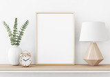 Fototapety Home interior poster mock up with vertical metal frame, plant in vase and lamp on white wall background. 3D rendering.