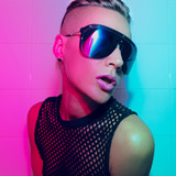 Tomboy Girl with short hair and luxury sunglasses. Fashion Party Style Clubbing neon light - 182884140
