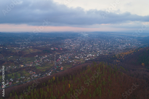 Foto op Canvas Chocoladebruin Small town in Carpathian Mountains. High-altitude aerial shooting.