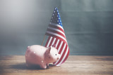 A piggy bank with an American flag - 182901172