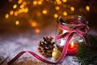 Leinwandbild Motiv Advent, Christmas  -  Burning candle in snow landscape with bokeh background