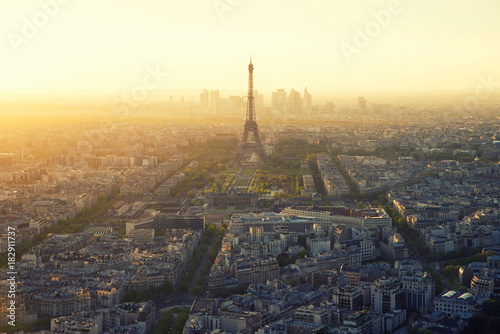 Poster Aerial view of Paris and Eiffel tower at sunset in Paris, France.