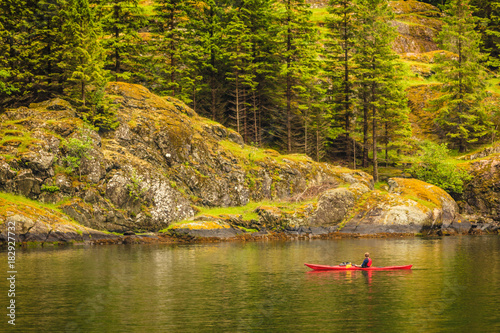 Sticker fjord in Norway and people kayaking