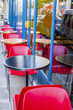 PARIS, FRANCE, on October 30, 2017. Empty little tables of hospitable attractive cafe stand on the sidewalk and expect visitors.