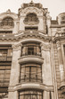 PARIS, FRANCE, on October 30, 2017. The sun lights the city street and typical architectural parts of houses of in downtown. Building facade fragment