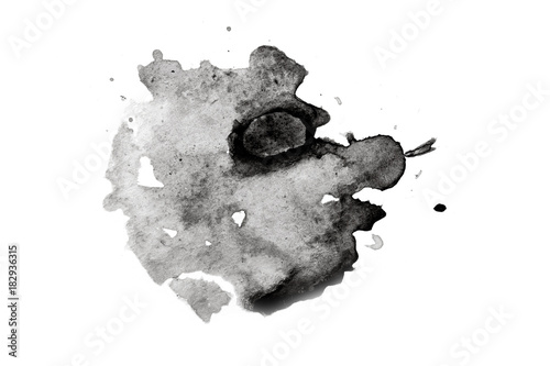abstract black splashes on white watercolor paper. monochrome image.