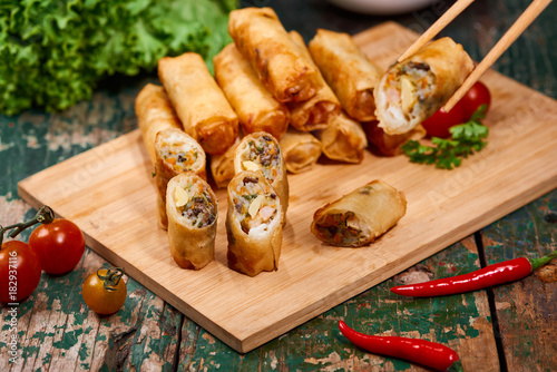 Sticker Vietnamese food. Delicious homemade spring rolls on wooden table.