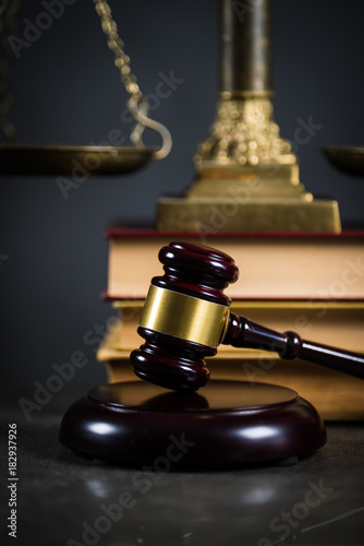 Fototapeta Golden scales of justice, gavel and books on brown background, Law code