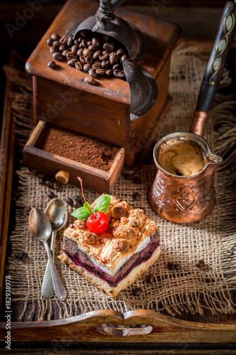 Plexiglas Kersen Closeup of cherry pie with pot boiled coffee
