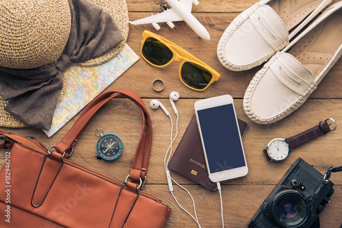 Fototapeta Travel accessories costumes for women. Passports, luggage, The cost of travel maps prepared for the trip