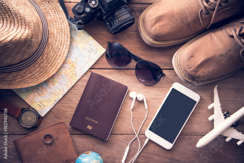 Fototapeta Travel accessories costumes for men. Passports, luggage, The cost of travel maps prepared for the trip