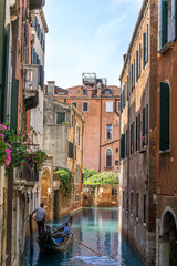 colorful Venetian Canal with gondola, Venice Italy