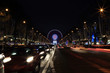 Paris, France. Christmas illumination decorations on avenue Champs-Elysees and Big Wheel at Place de la Concorde at night