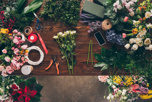 top view of white roses on florist table