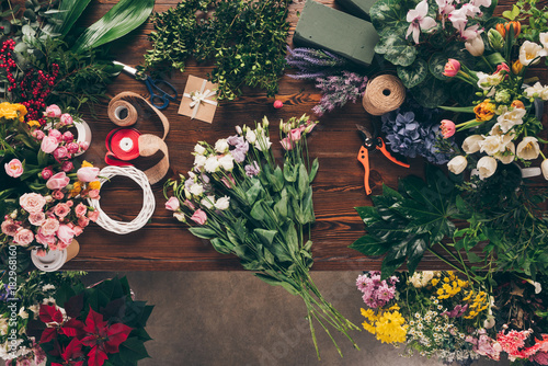 top view of bouquet of roses on florist table