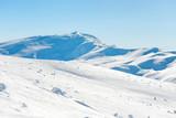 Range of mountains peaks in snow. Winter landscape