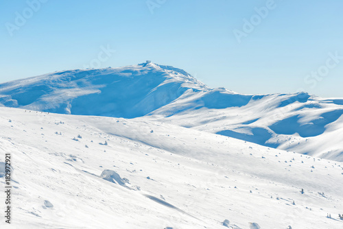 In de dag Pool Range of mountains peaks in snow. Winter landscape