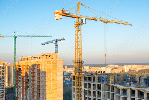 Cranes on industrial building site