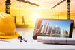 Digital Tablet And Hardhat On Blueprint