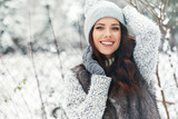 beautiful smiling young woman in wintertime outdoor. Winter concept - 182976783