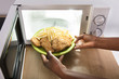 Person Heating Fried Food In Microwave Oven - 182981970