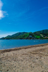 Beautiful outdoor view of Taganga, the caribbean coast with some tourists enjoying the sunny day in Colombia © Fotos 593