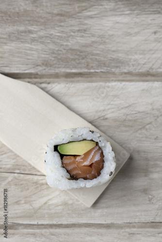 Plexiglas Sushi bar california roll in a wooden pallette