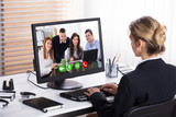 Businesswoman Video Conference With Her Colleagues