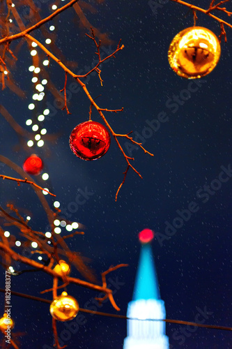 Tuinposter Moskou Streets of Moscow decorated for New Year and Christmas celebration. Tree with bright red and yellow balls. The St.Nicholas (Nikolskaya) tower of Kremlin on the background. Russia.