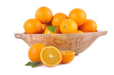 orange in wooden bowl and sliced orange on wite background  - 182989309