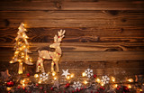 Christmas background with wooden decorations,moose and tree
