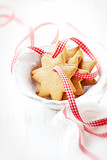 Gingerbread cookies with check ribbon in a bowl - 182993503
