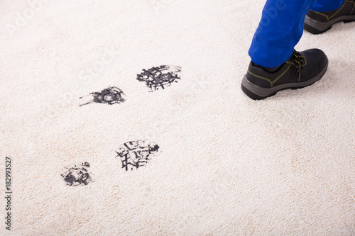 Foto op Canvas Wanddecoratie met eigen foto Elevated View Of Muddy Footprint On Carpet