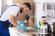 Man Cleaning Kitchen Worktop