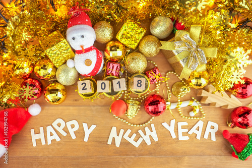Happy new year with 2018 wooden cube block and christmas props decorations against wood background.