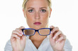 woman is holding a pair of glasses - 183000363