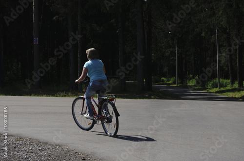 Deurstickers Fiets beautiful girl on a vintage bike